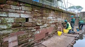 Masonry consolidate to tail race retaining wall
